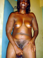 Black mom trying on big strap-on. It's..